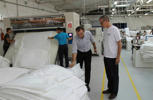 Ambassador Charles Garrett is given a tour of the Comfy Angel factory in Prilep