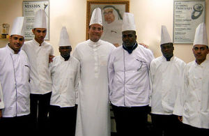 Mohammed Abdul Latif Jameel with trainee cooks from Bab Risq Jameel