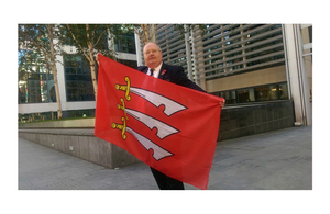 Secretary of State with Essex flag