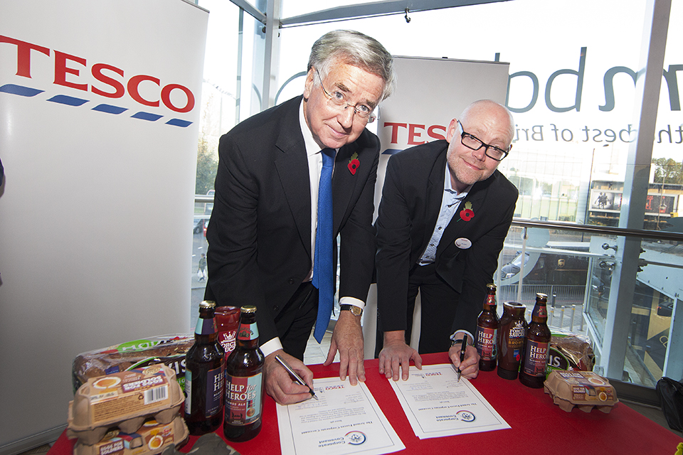 Defence Secretary Michael Fallon and UK Managing Director for Tesco Robin Terrell