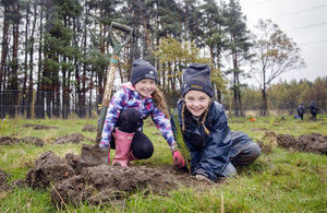 Pictured L-R Rosie and Karis, P5 children from Currie Primary School, Edinburgh, help with the tree planting.