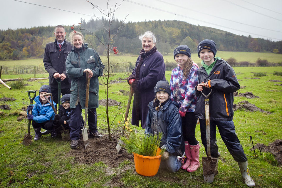 Pictured L-R (adults) Carol Evans, director of the Woodland Trust Scotland, Marc Watson, Sainsbury's Longstone store manager and Margaret Murison from Mid Calder. The P5 children from Currie Primary School are L-R: Olivia, Lewis, Karis, Rosie and Andrew