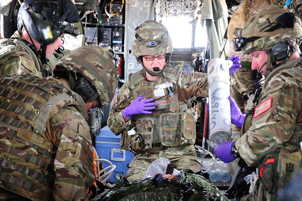 A casualty is tended to onboard a Chinook helicopter