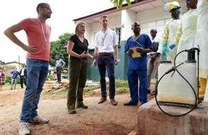 Justine Greening with British nurse Will Pooley in Sierra Leone. Picture: Staff Sergeant Tom Robinson/MOD