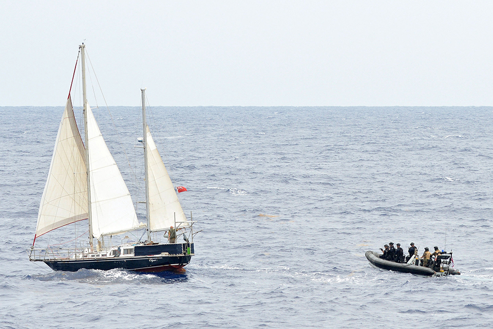 HMS Argyll's boarding team approaches the vessel suspected of carrying drugs