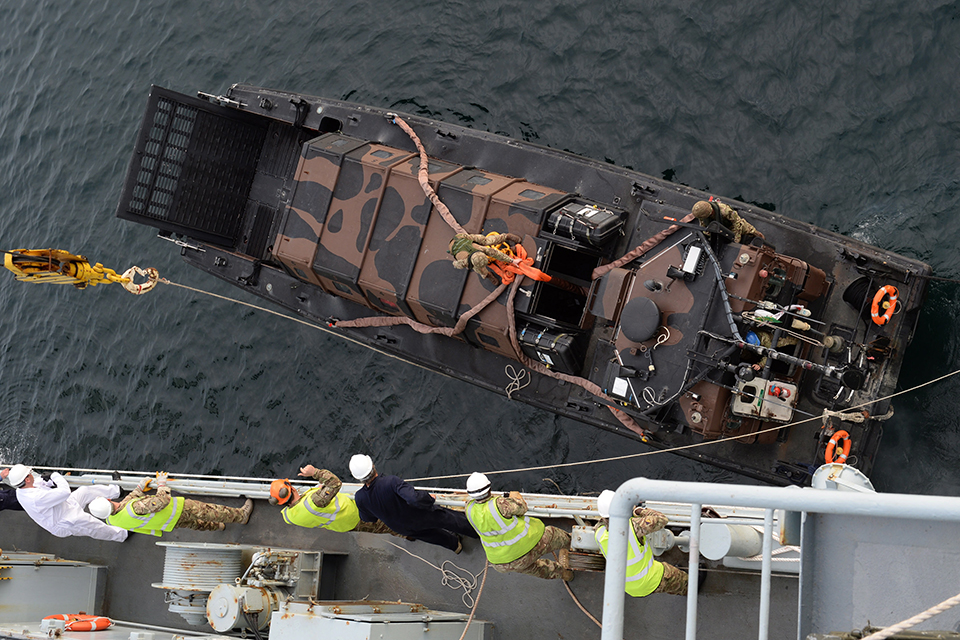A landing craft is lowered from RFA Argus