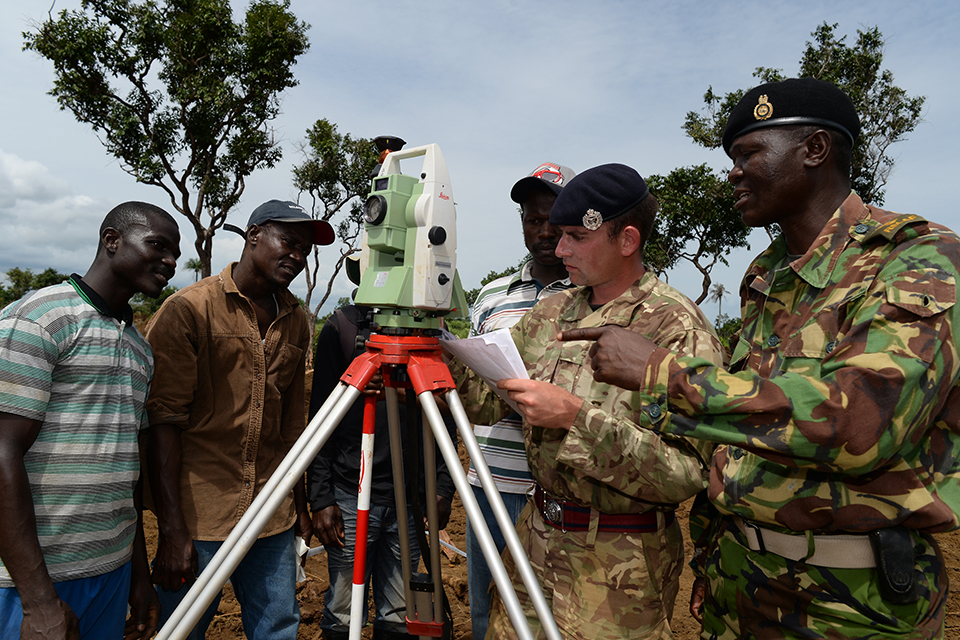 Sapper John Blackburn, Royal Engineers, discusses the build of a treatment centre with his Sierra Leone Armed Forces counterpart