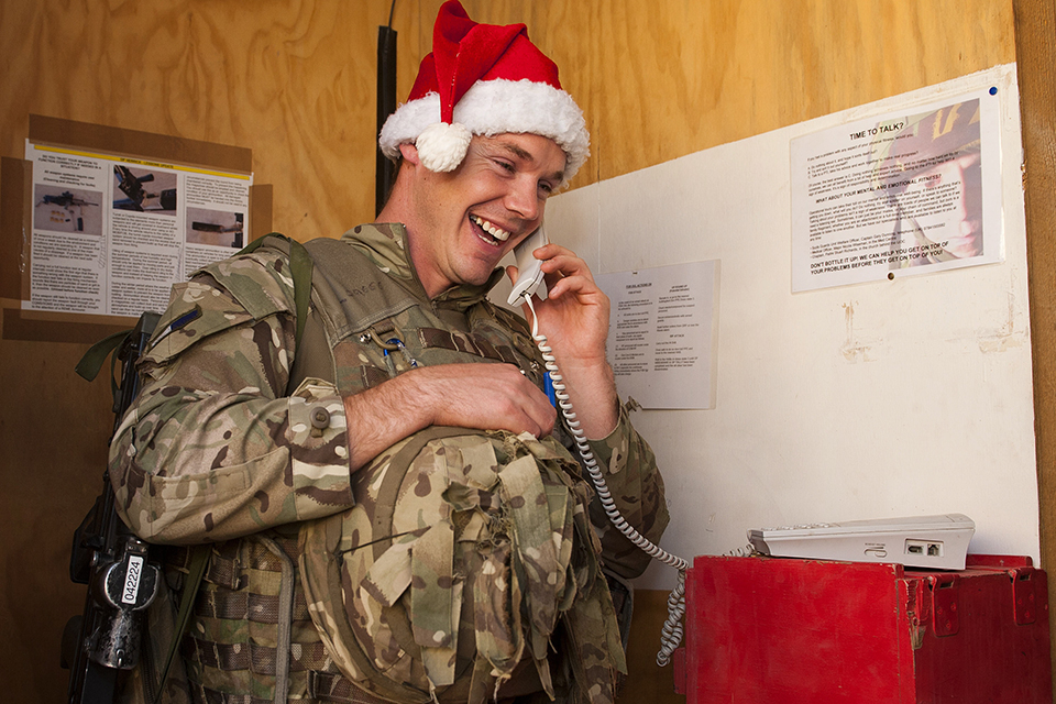 Soldier speaking to family at Christmas