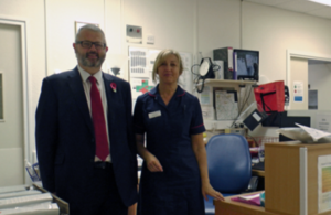 Adrian Masters with a member of staff at South Warwickshire NHS Foundation Trust.