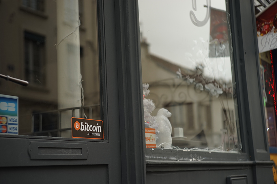'Bitcoin accepted here' sign in a window