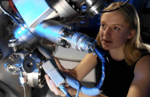Woman scientist working on a mass spectrometer