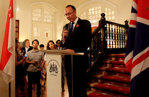 High Commissioner addressing the guests.