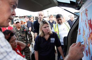 International Development Secretary Justine Greening receives a briefing during a visit to Tacloban in the aftermath of Typhoon Haiyan, November 2013.