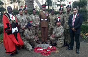 Lord Ahmad with cadets and the Mayor of Lambeth, Councillor Adedamola Aminu