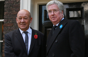 French Defence Minister Jean-Yves le Drian and Defence Secretary Michael Fallon swap Poppies and Bleuets [Picture: Harland Quarrington, Crown copyright]