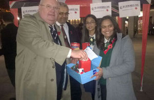 Eric Pickles donating to We Remember Too outside Westminster Cathedral