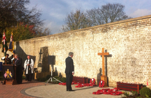 Defence Secretary Michael Fallon pays his respects in Aylesford on Armistice Day [Picture: Crown copyright]