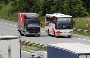 HGV and coach on road