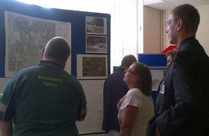 Environment Agency staff talking to community members