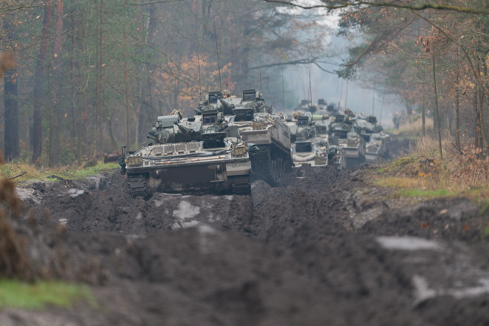 A column of Warrior Armoured fighting vehicles move through an autumnal forest track in Poland [Picture: Staff Sergeant Mark Nesbit RLC Crown copyright]