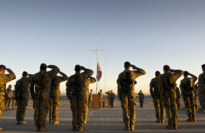 Garrison Sergeant Major Andrew Stephens (RAF) Lowers the Union flag for the last time at Kandahar Air base, Afghanistan [Picture: Corporal Andrew Morris (RAF), Crown copyright]