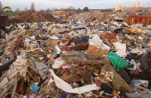 Piles of rotting waste with Lincoln Cathedral in the distance