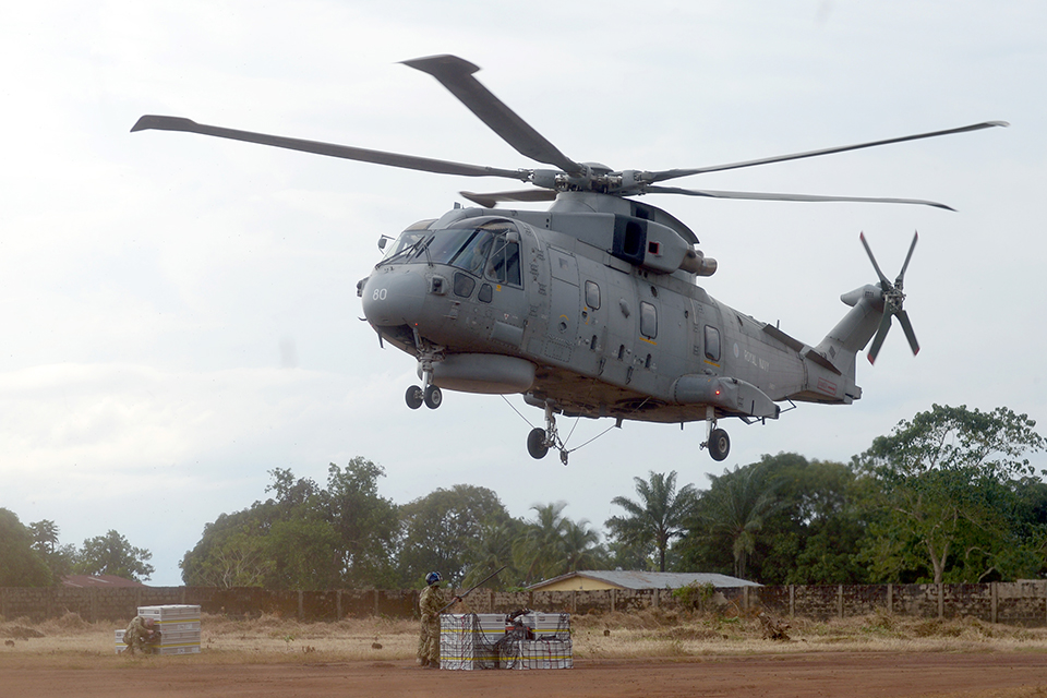 A Royal Navy Merlin helicopter delivers supplies