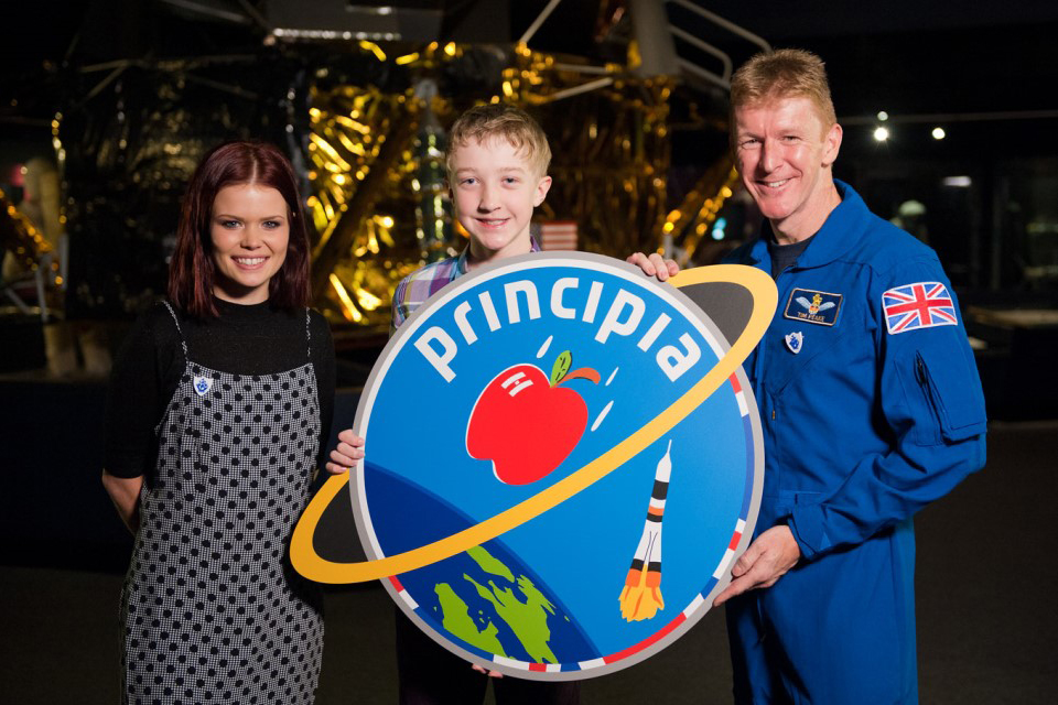 Lindsey, Troy and Tim holding the Principia mission patch.