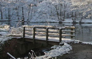 Image of snow scene of foot bridge near the pools at Birches valley visiting centre. Cannock Chase. Rugeley. Staffordshire.