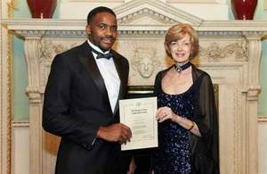 Sam Peter with the Lord Mayor of the City of London, Alderman Fiona Woolf, at the City Banquet at Mansion House