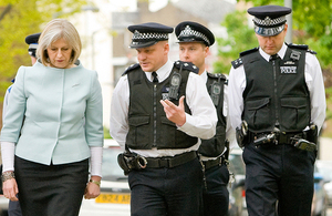 Home Secretary with police