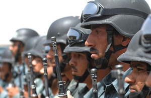 Afghan National Police recruits from both the basic and non-commissioned officer patrolman's course parade after an exercise