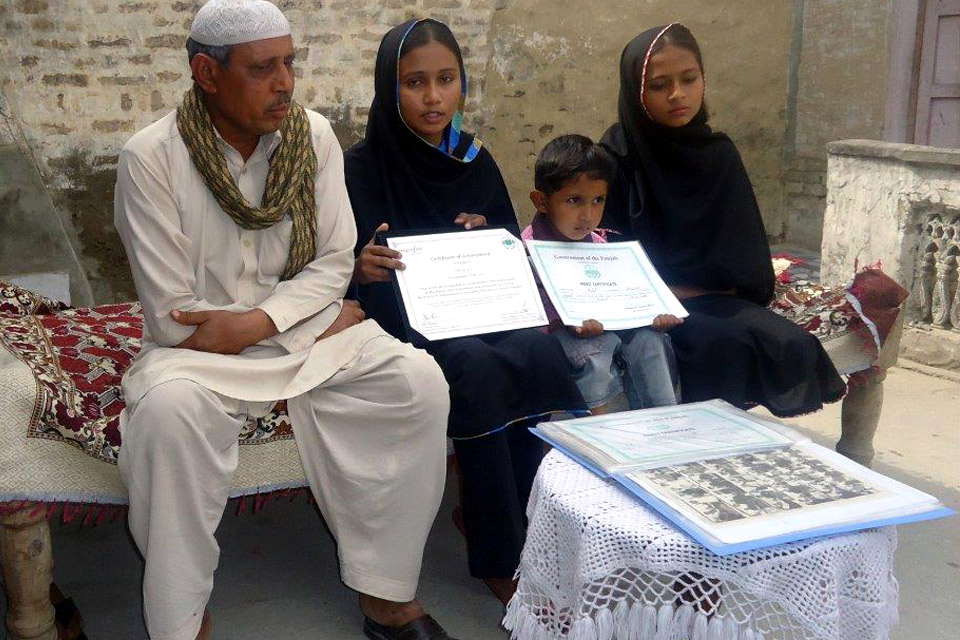 Faryal and her younger brother proudly show off her certificates of achievement. Picture: Punjab Education Foundation