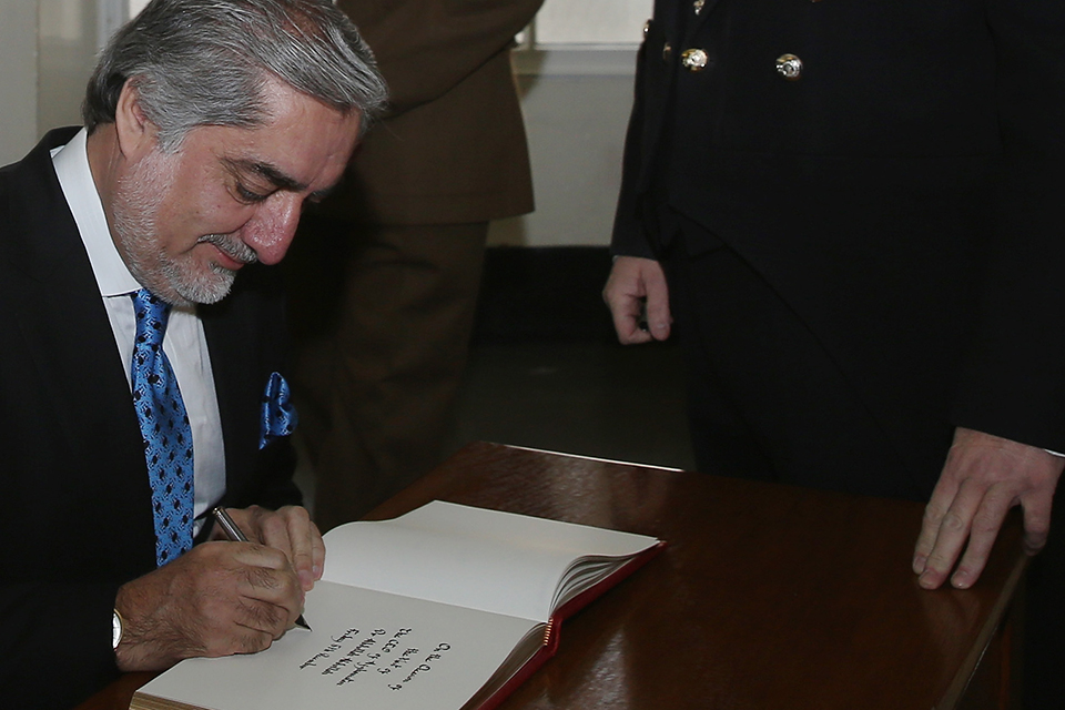 Abdullah Abdullah signs the visitors