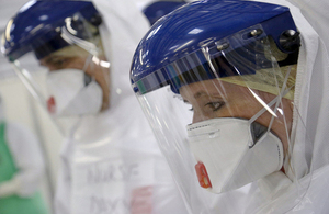 NHS medics in protective suits prepare for deployment to Sierra Leone. Picture: Simon Davis/DFID