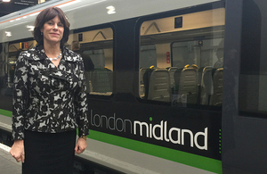 Claire Perry with London Midland train.