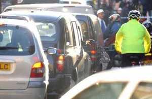 Cyclist negotiating city traffic