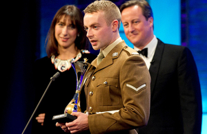 Prime Minister David Cameron and wife Samantha presented the award for Best Reservist to Lance Corporal Keith Mallon (library image) [Picture: Copyright The Sun]