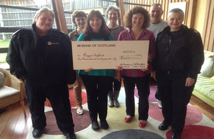 Elaine handing over the cheque to Maggie's Highland Cancer Centre