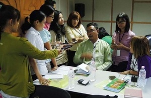 Participants interviewing an official from Environmental Conservation Ministry
