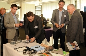 A picture of delegates looking at the 3D scanning system developed by Fuel 3D