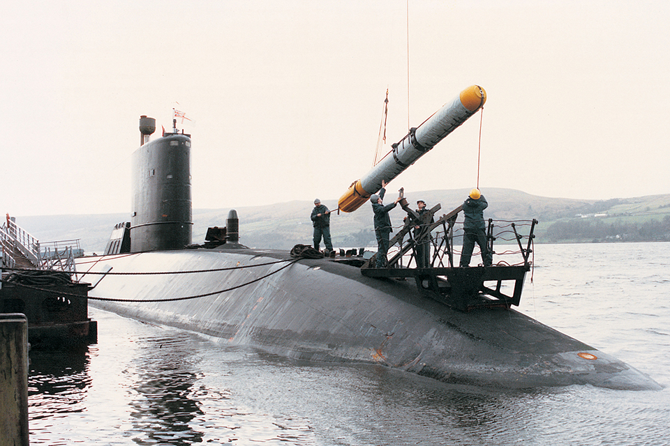 A Spearfish torpedo being loaded into a Royal Navy submarine