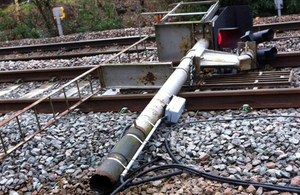 Collapsed signal T2865 lying across the down line closest to the camera (train 1A83 was running on the further of the two lines) (photograph courtesy of Network Rail)