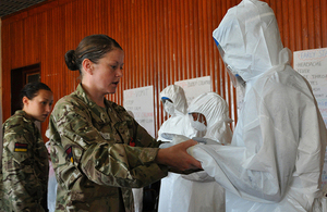 Medics from 5 Medical Regiment teaching the correct procedure for wearing personal protective equipment [Picture: Major Si Reeves RM, Crown copyright]