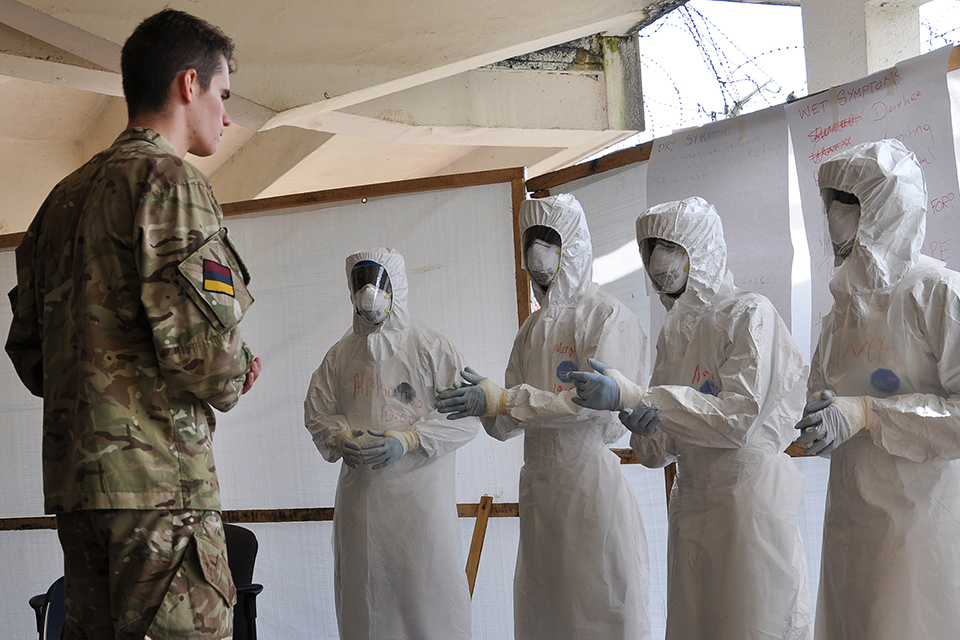 A medic from 5 Medical Regiment giving personal protective equipment lessons