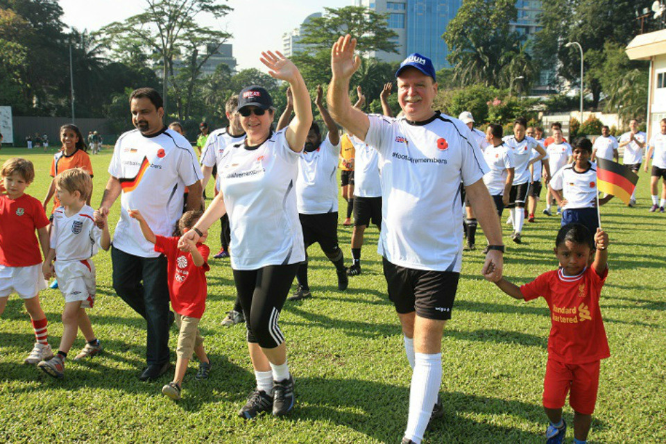 British High Commissioner to Malaysia Vicki Treadell CMG, MVO and German  Ambassador to Malaysia H.E. Holger Michael leading out the players at the #FootballRemembers match in Malaysia