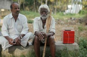 An image of two villagers in rural India with the Buffalo Grid Hub