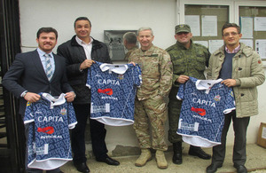 Lieutenant Colonel David Jones presenting the new rugby uniform to Kosovo Roosters Rugby Club outside British Embassy Pristina.  Left to Right: Veli Hoti, Philip Mellish; Lt Col David Jones; Dukagjin Hysenaj and Denis Dautaj