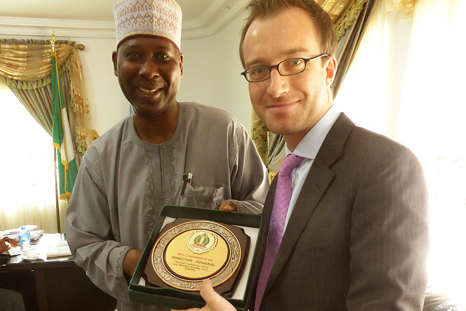 National Institute for Policy & Strategic Studies Director General, Professor Tijjani Muhammad-Bande presents a plaque to Head of Delegation, Nigel Holmes who leads on the UK political relationship with Northern Nigeria.
