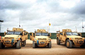 Husky protected support vehicles are lined up at the Stanford training facility in Norfolk (STANTA) (library image) [Picture: Crown copyright]